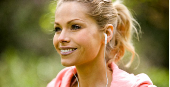 Female Runner Wearing Headphones, Close-Up